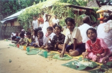 Children having prasad inside the asrama premises during the